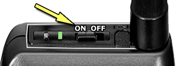 The power button is located on the top of the unit by the antena.